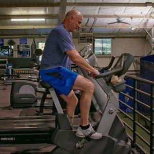 senior man on fitness cycle
