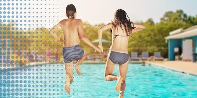 boy and girl jumping into pool